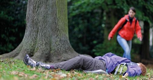 Woman lyhing in park